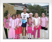 Will Wynn poses with children at Susan G. Komen Race for the Cure
