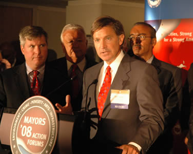Will Wynn is joined by numerous other mayors at a press conference in New York City