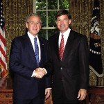 President George W. Bush honors Will Wynn in the Oval Office for the City of Austin's policies relating to its employees serving in Iraq and Afghanistan. Wynn was also honored at a ceremony at the Pentagon.
