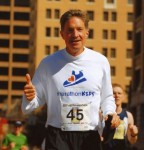 Wearing bib #45 (representing his age), Will Wynn nears the finish line of the 2007 Austin Marathon. He became the first mayor in history to run his/her city's marathon while in office. Wynn used the run to raise over $20,000 for the non-profit MarathonKids.