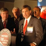 Will Wynn is joined by numerous other mayors at a press conference in New York City. Wynn had just presented an Energy Action Platform to the domestic advisory teams of both Senators McCain and Obama during the final stages of the 2008 presidential campaign.