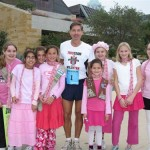 At the Race for the Cure, Will Wynn says thank you to the St. Austin's Girl Scout Troop 2060, who cheered on more than 23,000 participants. Wynn, wearing bib #1, formed a team of mostly city employees to join in on the event that raised over $1.5 million.